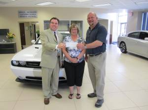 From left to right Jason Scott, General Manager at Dick Scott Chrysler Dodge Jeep Ram; Liz Salliotte, Administrative Assistant at Northville High School; and Bryan Masi, Athletic Director at Northville High School.